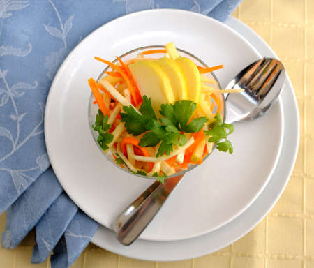 celery root: Salad of celery root and leaf, carrot and apple Stock Photo