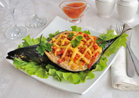 Mackerel stuffed with vegetables and cheese with lettuce photo