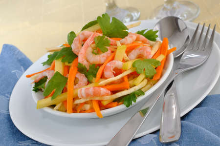 celery root: Salad of celery root and leaves with carrots, apples and shrimp Stock Photo