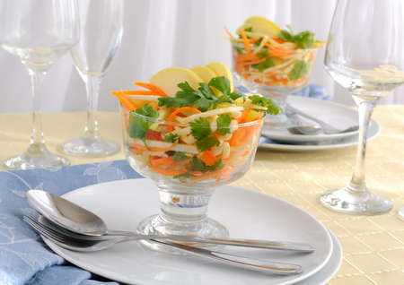 Salad of celery root and leaf, carrot and apple photo