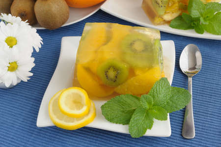 With a variety of fruit jelly with mint close up photo