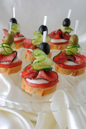 Canape of the baguette with salami on a glass base Stock Photo - 15133367