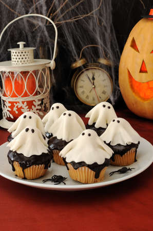 halloween decoration: Muffins with chocolate haunted putty Stock Photo