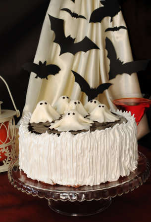 Cake with marzipan ghosts to chocolate and cream protein