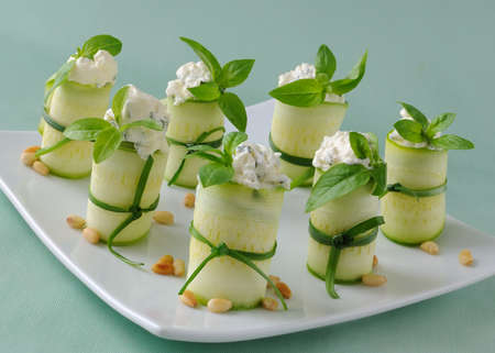 Rolls of zucchini stuffed with ricotta and basil and pine nuts photo