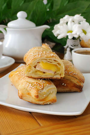 Roll out puff pastry with ham and cheese photo