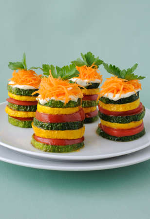 Pinnacles of yellow and green zucchini with tomato photo