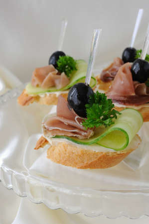 Mini sandwiches with ham and cucumber on a baguette Stock Photo - 15447682