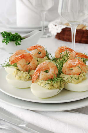 food buffet: eggs stuffed with spicy stuffing with grilled shrimp Stock Photo