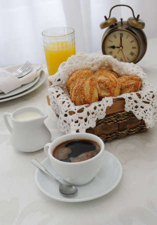 coffee hour: Morning cup of coffee with freshly baked rolls with sesame seeds, juice and milk