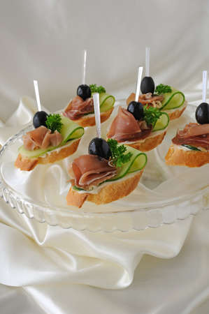 Mini sandwiches with ham and cucumber on a baguette Stock Photo - 16588087