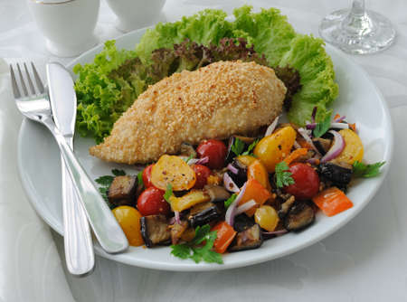 Chicken schnitzel with sesame with eggplant, tomato and pepper
