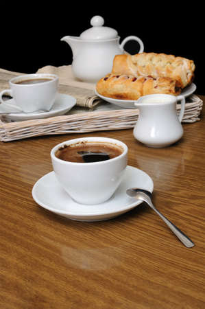 milkman: A cup of black coffee with a milkman with pies on a tray with newspaper Stock Photo