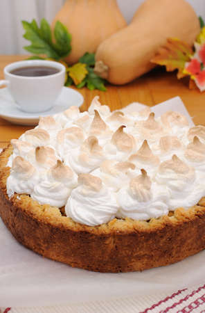 Pumpkin pie with pyramids of protein cream closeup photo