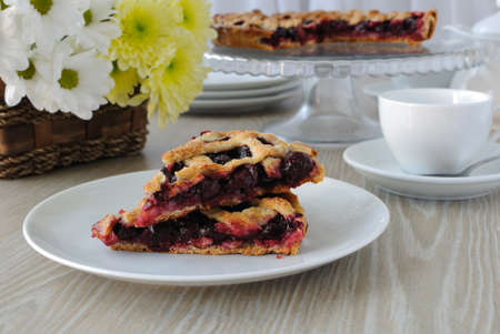 Two slice of cherry pie on a plate on the table Stock Photo - 16825859
