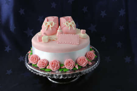 Cake with booties and toys made of marzipan
