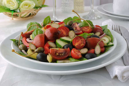 Salad of summer vegetables with basil and capers photo