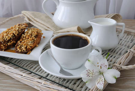 collation: French toast with walnuts and cinnamon and a cup of coffee Stock Photo