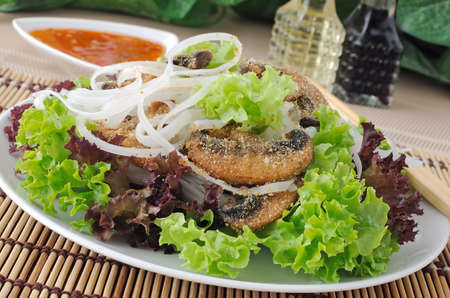Salad of rice noodles in lettuce leaves with mushrooms in breadcrumbs photo