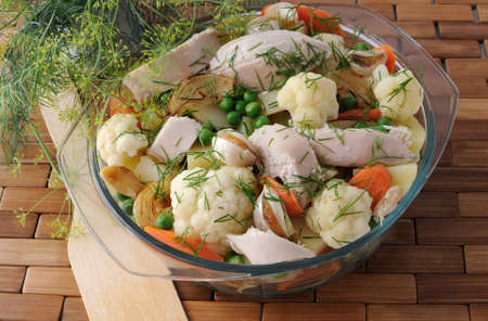 Roasted vegetables with slices of chicken and fennel in a pan