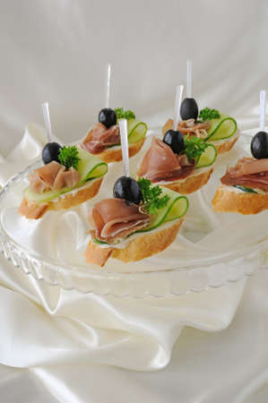 Mini sandwiches with ham and cucumber on a baguette Stock Photo - 19021584