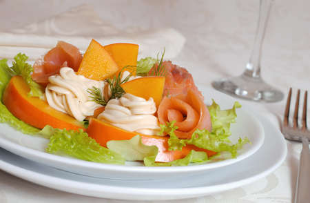 Salmon salad with persimmon and cream cheese closeup photo