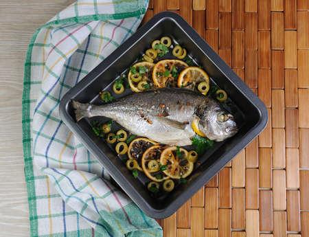 Baked Fish (Dorado) with lemon and olives    photo