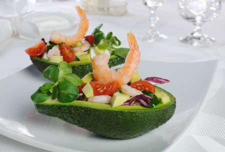 tender appetizer of avocado and shrimp with vegetables