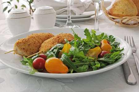 Chicken Schnitzel with arugula and cherry tomatoes