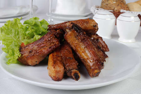 Pork ribs in honey and soy sauce with garlic Standard-Bild