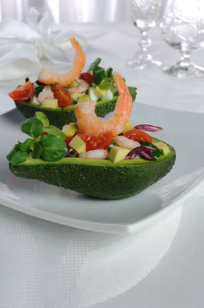 tender appetizer of avocado and shrimp with vegetables photo