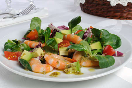 food buffet: Salad of watercress, cherry tomato and avocado with prawns