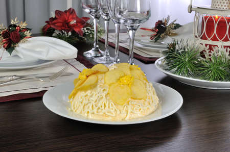 multilayer: Multi-layer salad with mayonnaise with the flowers of chips