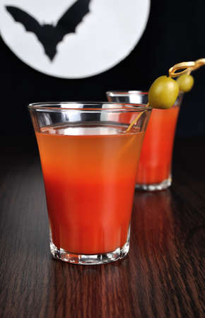 Bloody Mary cocktail with olives on a background of the moon