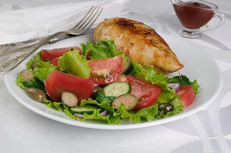 schnitzel: Easy  garnish  of fresh vegetables with chicken schnitzel Stock Photo