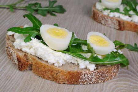 quail egg: Sandwich with arugula and quail egg with leaves of arugula