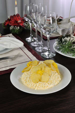 collation: Multi-layer salad with mayonnaise with the flowers of chips