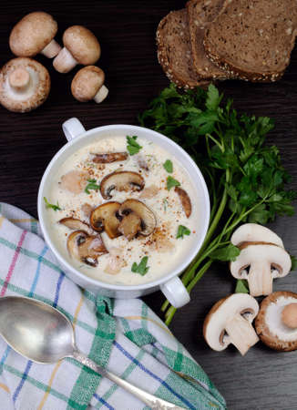 pureed: creamy soup pureed mushrooms and slices of chicken