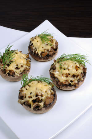 champignons: champignons with vegetable stuffing and cheese Stock Photo