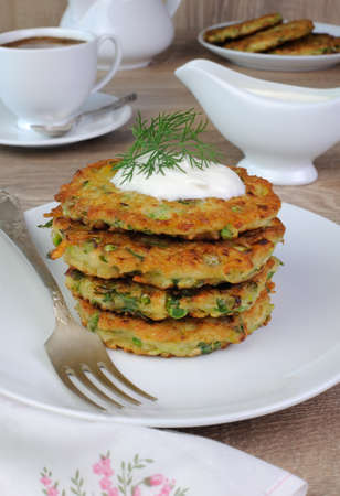 fritter: Vegetable fritters of zucchini with peas and herbs