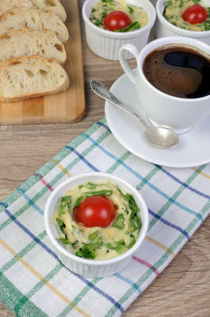 elevenses: Omelet  spinach and cheese in the form of a batch with a cup of coffee
