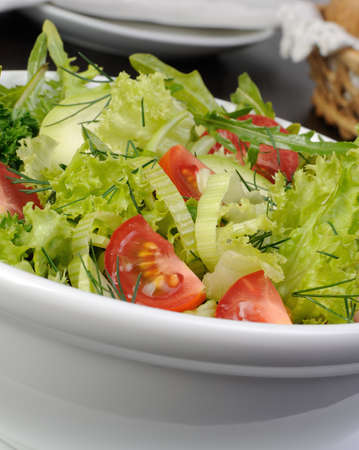 Light summer salad of lettuce with arugula and cherry tomatoes
