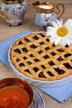 elevenses: Pie shortcrust pastry with cherry filling Stock Photo