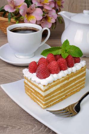 honey cake: Piece of honey cake with whipped cream and raspberries