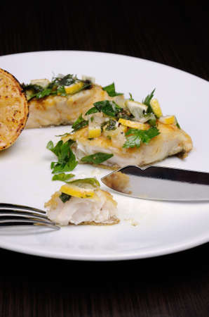 morsel: slice of baked fish perch with herbs and lemon slices
