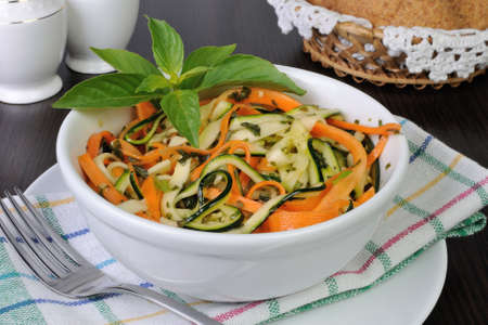 elevenses: Salad with strips of carrot and zucchini pesto sauce Stock Photo