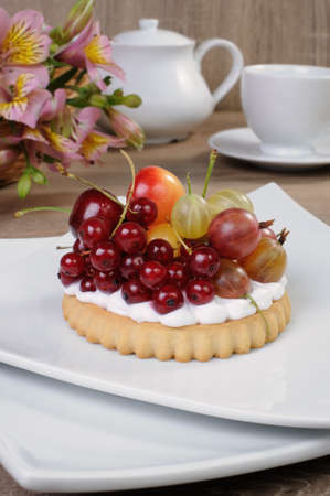 elevenses: Dessert of sand tarts with whipped cream and fresh fruit Stock Photo