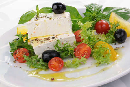 elevenses: Cubes of feta cheese in oil with spices, cherry tomatoes and olives