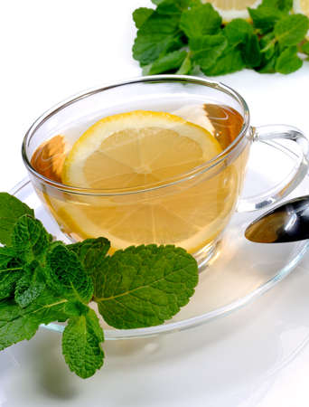 warming therapy: Cup of tea with a slice of lemon, mint and cinnamon
