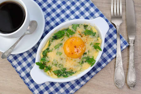 egg  yolk: baked spinach and cheese with egg yolk cup of coffee
